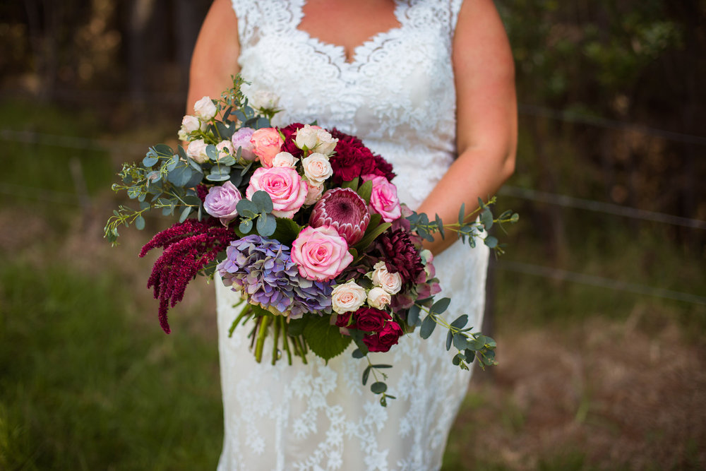 Beautiful burgundy flowers | Astra bride Martine | Maggie Sottero Londyn | Sante Fe at Ahipara | Nicole Jecentho Photographer