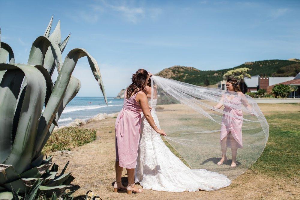 Preparing the veil   Astra Bride Karla   Te Awa Winery wedding   Maggie Sottero Chesney   Ash PHotography