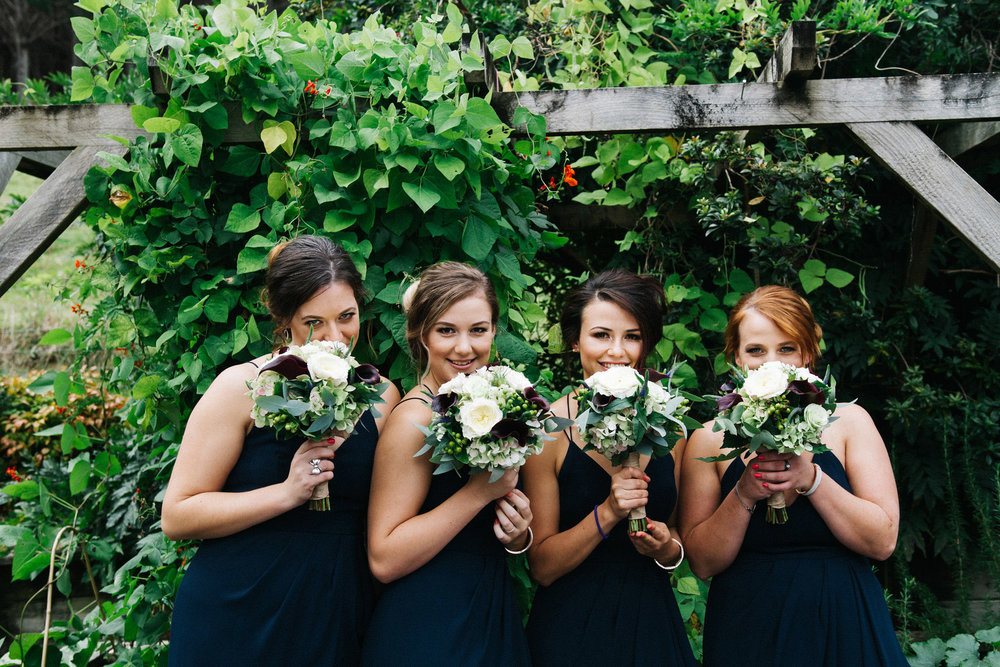 Astra bride Rhiannon | Maggie Sottero Collins | Dark blue bridesmaids dresses | Wedding at home | Mason Bennett Photography |