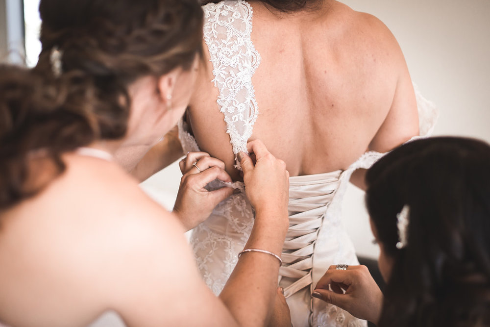 Getting dressed | Astra bride Erin | Christina Rossi 4246 | Te Awa Winery | Josh Neilson Photography