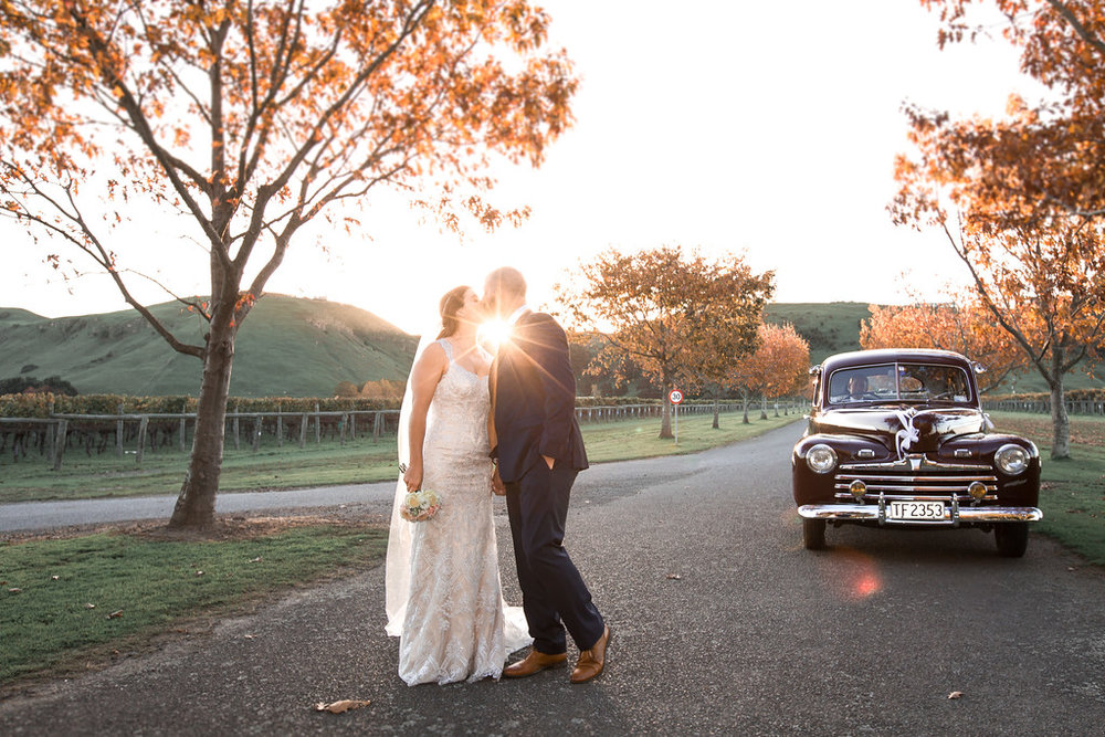 Sunset kiss | Astra bride Erin | Christina Rossi 4246 | Te Awa Winery | Josh Neilson Photography