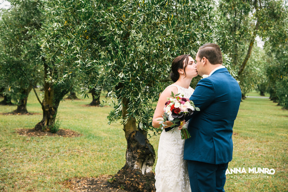 Kiss the Bride - Olive Grove Backdrop | Astra Bride Renee | Maggie Sottero Winifred | Brackenridge Country Retreat & Spa | Anna Munro Photography