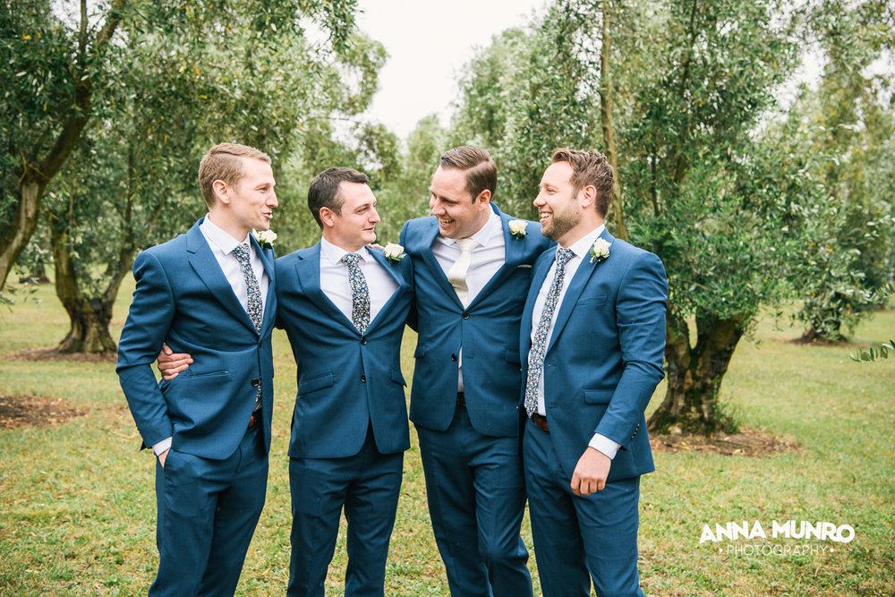 The Groomsmen - Olive Grove Backdrop | Astra Bride Renee | Maggie Sottero Winifred | Brackenridge Country Retreat & Spa | Anna Munro Photography