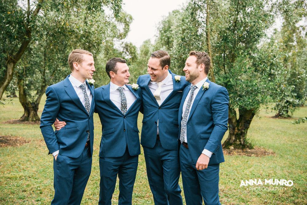 The Groomsmen - Olive Grove Backdrop | Astra Bride Renee | Maggie Sottero Winifred | Brackenridge Country Retreat & Spa | Anna Munro Photography