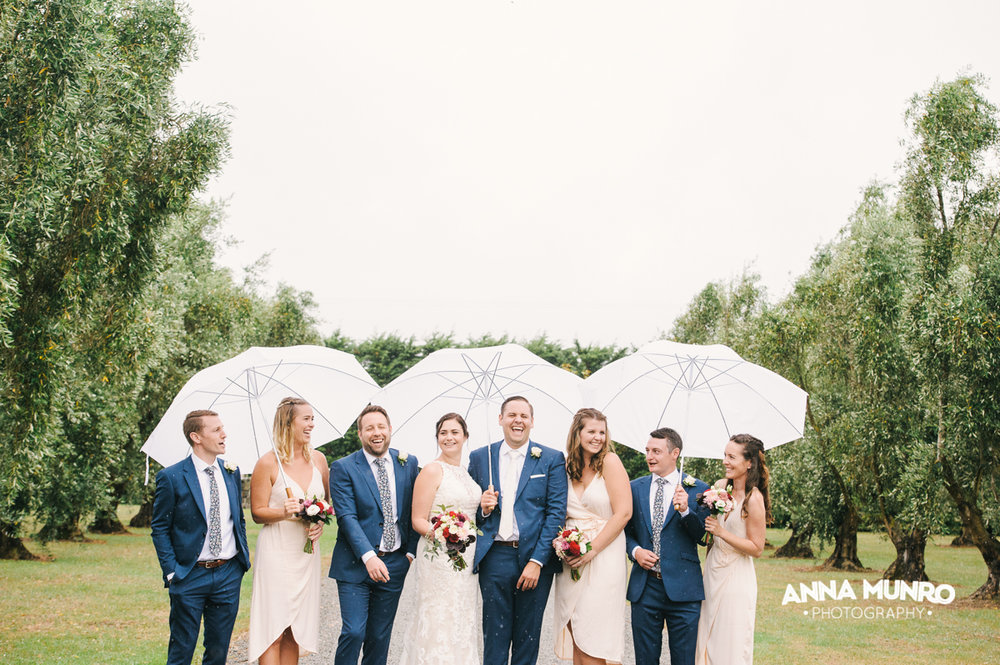 Bridal Party & A touch of rain in an Olive Grove | Astra Bride Renee | Maggie Sottero Winifred | Brackenridge Country Retreat & Spa | Anna Munro Photography