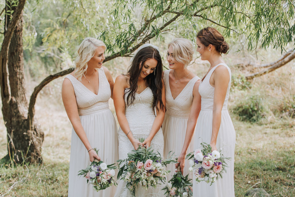 White bridesmaid dresses | Astra Bride Stacey | Maggie Sottero Mirian | Boho wedding at home | Tinted Photography