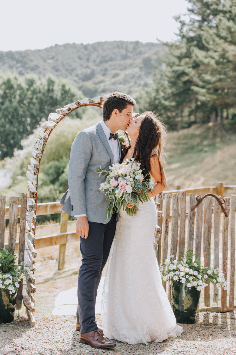 Wedding arch | Astra Bride Stacey | Maggie Sottero Mirian | Boho wedding at home | Tinted Photography