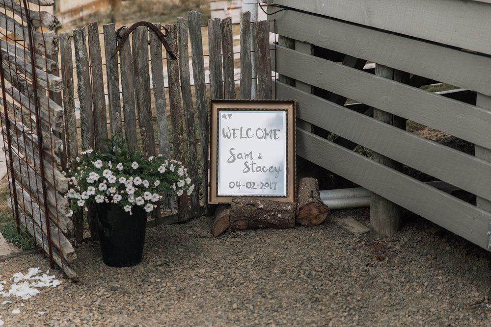 Welcome sign | Astra Bride Stacey | Maggie Sottero Mirian | Boho wedding at home | Tinted Photography