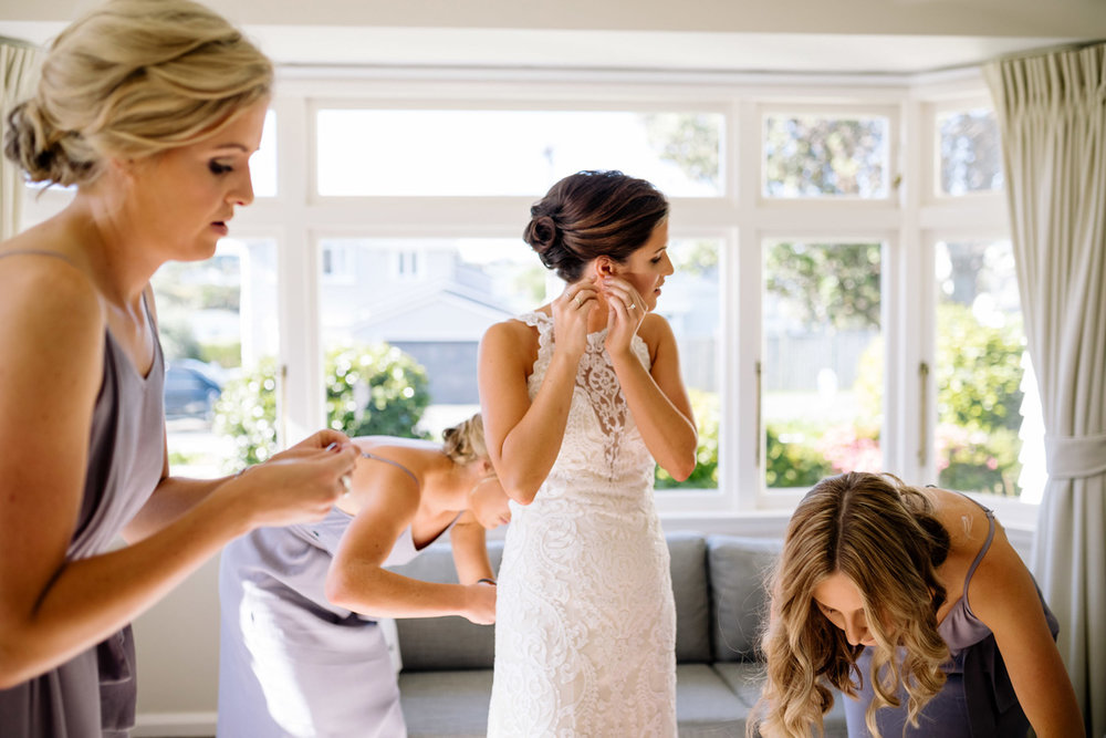 Getting dressed | Astra Bride Helena | Sottero & Midgley Winifred | Te Papa Wedding | The Official Photographers