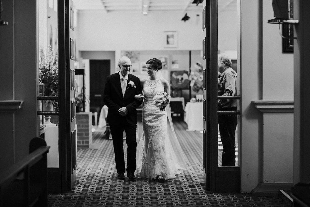 In to the church | Astra Bride Helena | Sottero & Midgley Winifred | Te Papa Wedding | The Official Photographers