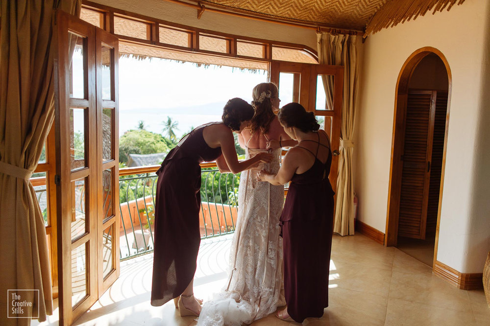 Lacing up the gown | Astra Bride Krystal