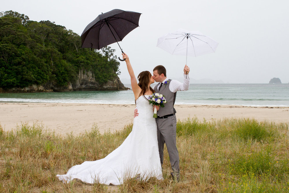A Kiss in the Rain | Bridal Outlet Bride Sarah