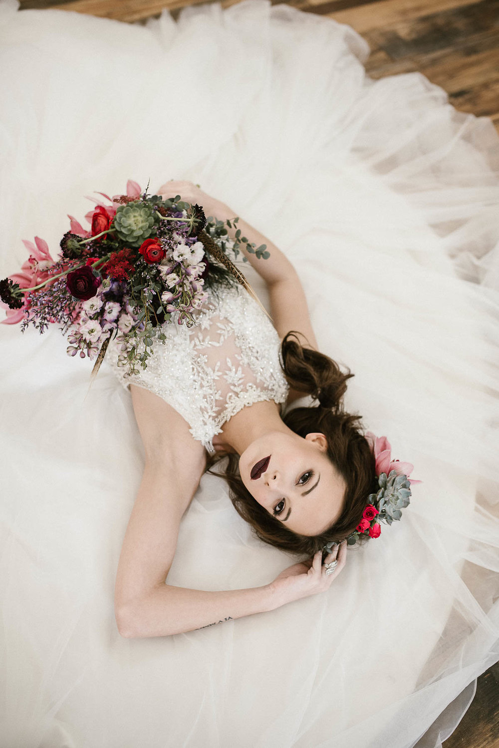 Inspire Me... - This captivating shoot was put together by the talented team at Finding Eden Photo, showcasing our very own Maggie Sottero 'Lisette' gown, in all it's princess glory!The delicate and wispy layers of tulle in the skirt are crowned with an intricately beaded lace bodice, overlaying a soft but scandalously deep V-neck line.