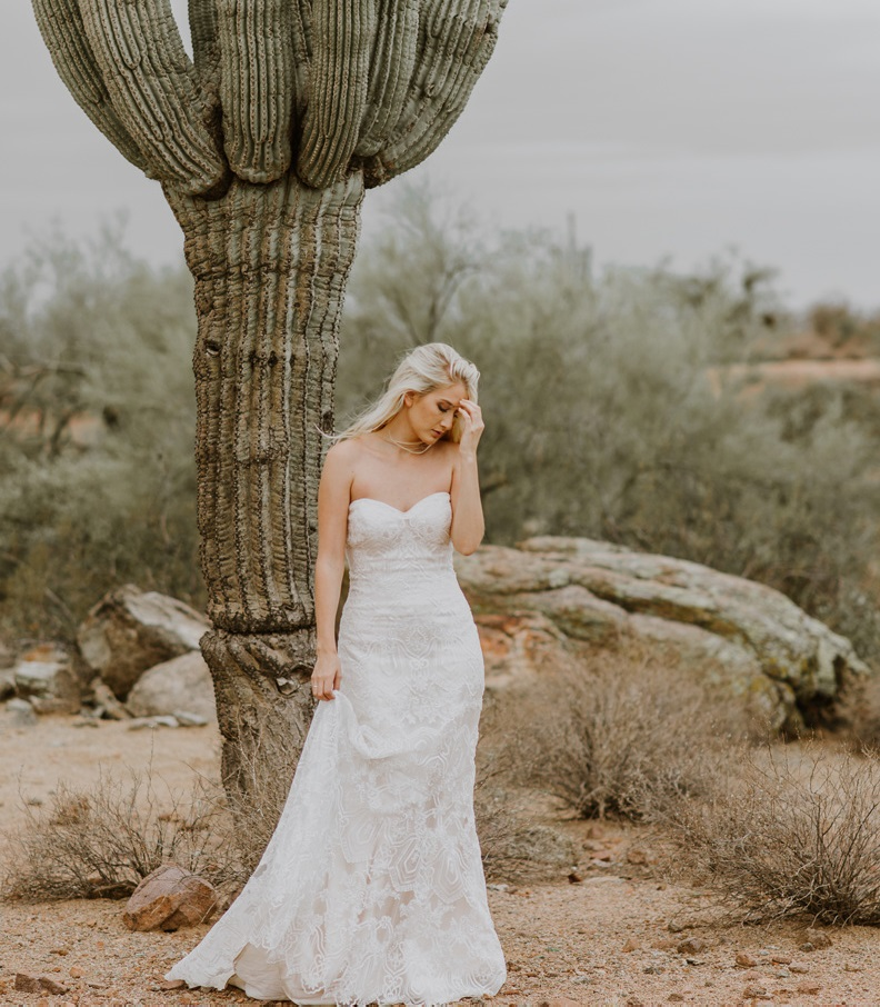 Deep in the Desert in Pheonix, Arizona - The beautiful lace of the Maggie Sottero Fredricka looks stunning against the arid backdrop of the desert.