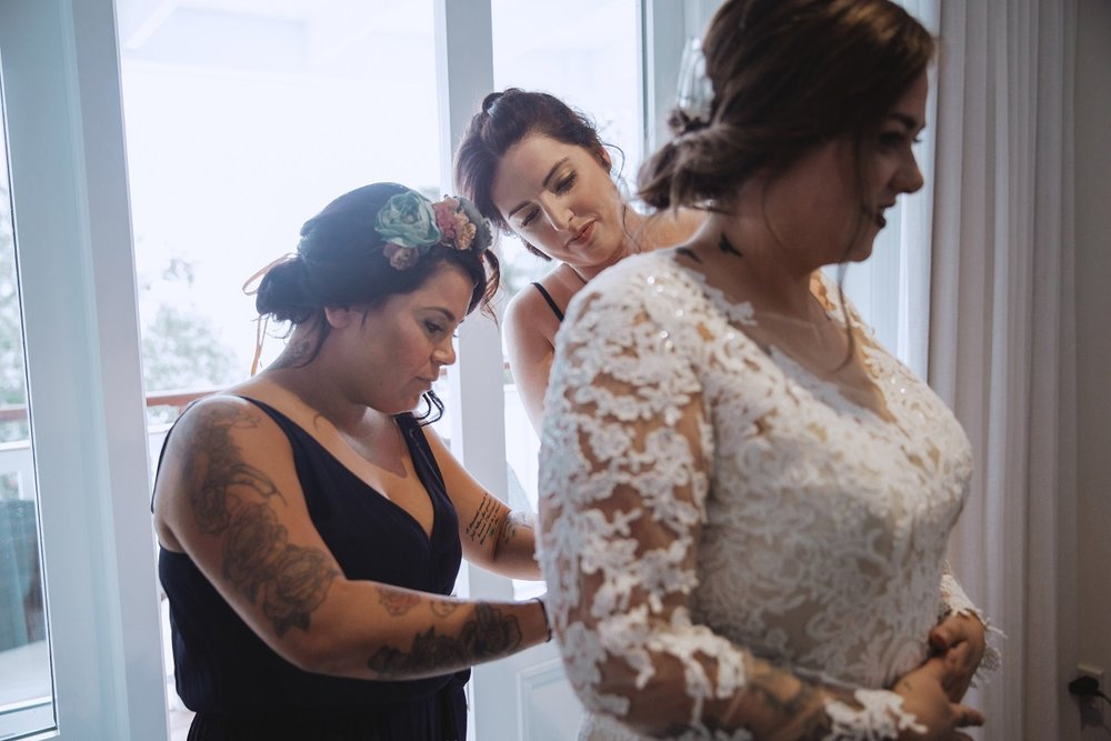 Doing up the gown | Astra Bride Jessica