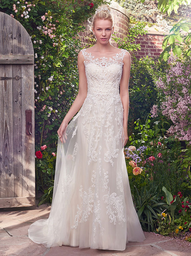 Get the Look - If you fell in love distinctive crosshatch motifs embellished with Swarovski crystals, delicate beading, and sequins then click the button below to make an appointment to try it on at your nearest Astra Bridal.