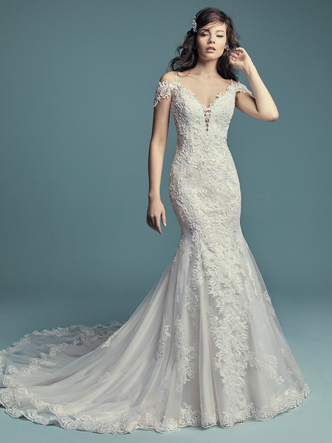 Maggie Sottero's -Della - Your best side will be accentuated beautifully in this number!