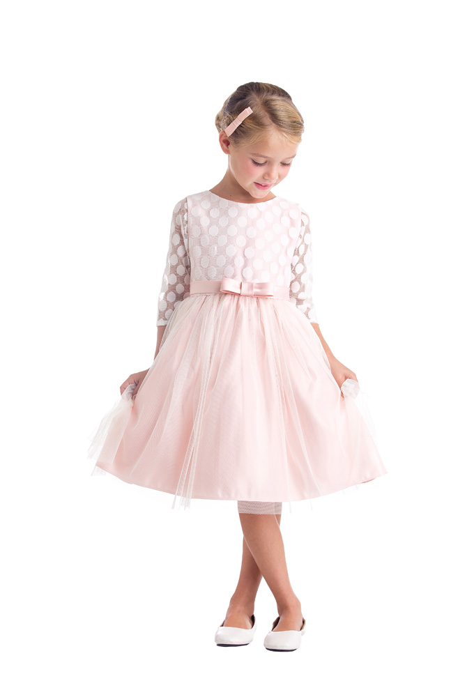 #6 - Dottie - This cute dress has the most stunning dotted tulle overlay on the bodie and sleeves. The tulle skirt gathers at the waist and is finished with a sation bow. The back has ties to give flexible fit.