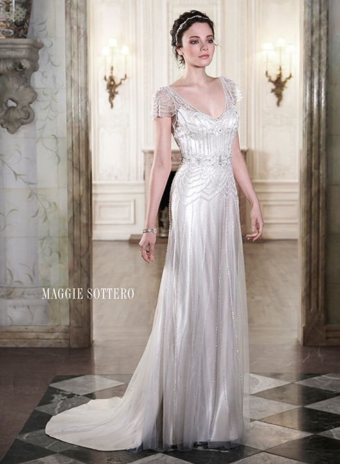 Get that look... - If you love the perfect blend of romance and refined sophistication in this tulle and Vogue satin sheath dress, complete with delicate tulle overlay, adorned with sparkling Swarovski crystals and pearl beads then click on the button below to make an appointment to try the Ettia on.