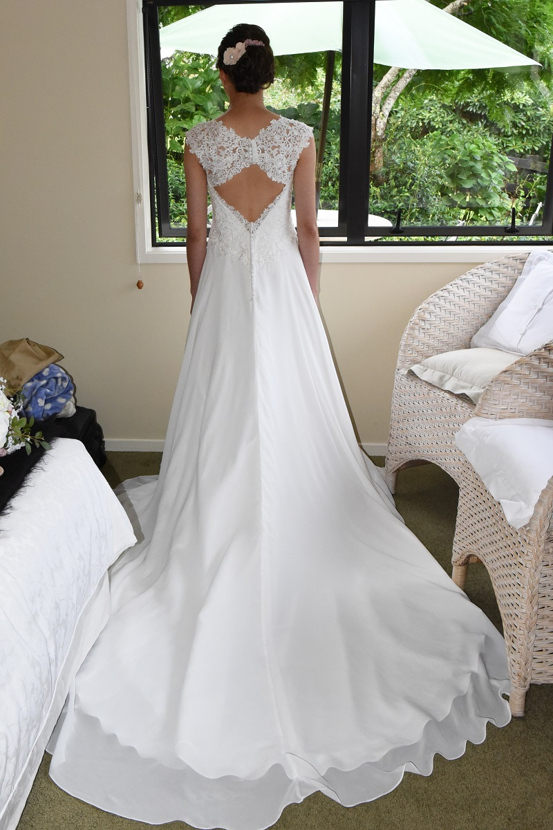 Gorgeous lace & chiffon... - was why Rebekah chose the Bonny 6527 bridal gown for her Big Day. The lace bodice was nice and simple, in keeping with their theme, and the keyhole back was stunning.