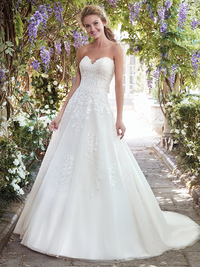 - If you loved Katie's gorgeous full ball gown with its delicate lace detail and sweetheart neckline, then click on the link below to make an appointment at your nearest Astra Bridal salon to try it on!