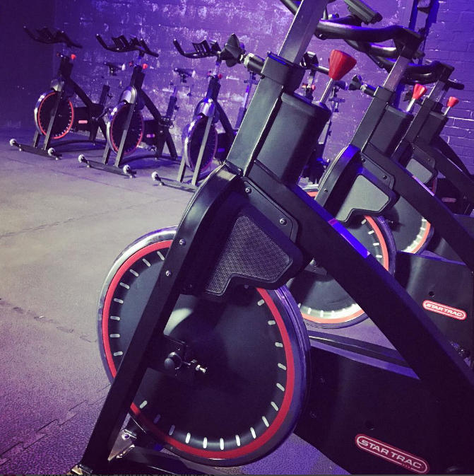 SPIN  - Members love our Spin classes which take place in our Dark Room, where no one can see you sweat! Bring a towel and some water for a 45 minute class packed with energy as Tom, Chud, Stew or Lucy takes you through a series of sprints, hill climbs and intervals to get your fitness through the roof. With our Star Trac bikes and monster playlists, we recommend booking early as these seats fill up fast!