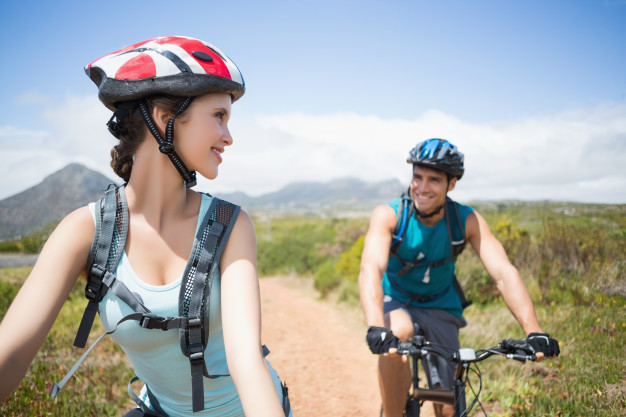athletic-couple-mountain-biking_13339-93717.jpg
