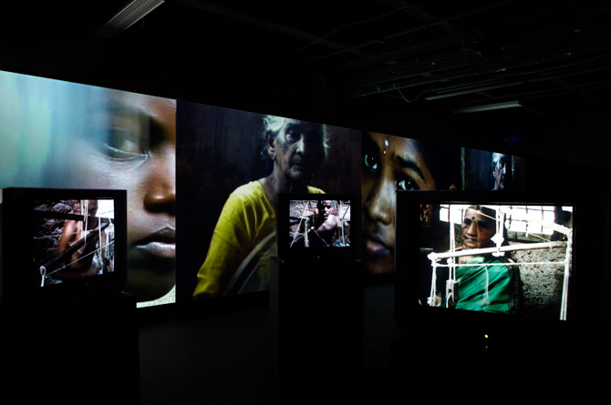 2006 La Fabrique, Video Installation with 4 wall projections, 25 TVs, 29 sound sources. coll. FNAC, Paris