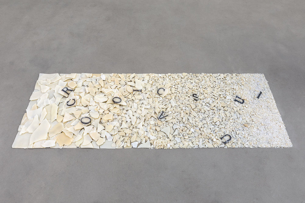 SEL DE LA NUIT, 2018  Broken up wax on the floor and lead words Variable size  Courtesy the artist and Rabouan Moussion Gallery Photo Credit : Romain Darnaud