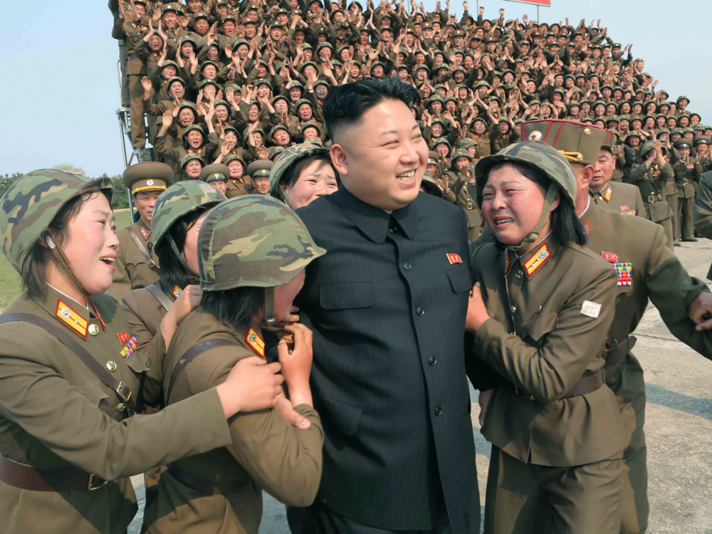 North Korean leader Kim Jong Un greets a women's subunit during a rocket launching drill Reuters/KCNA KCNA