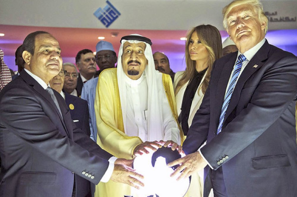 Of all the images, cartoons, and photos of Trump in his first year, this wins the Gropers of the World first prize. President Abdel Fattah el-Sisi of Egypt, King Salman of Saudi Arabia, and Melania and Donald Trump, with a globe in the Global Center for Combating Extremist Ideology in Riyadh, May 2017.