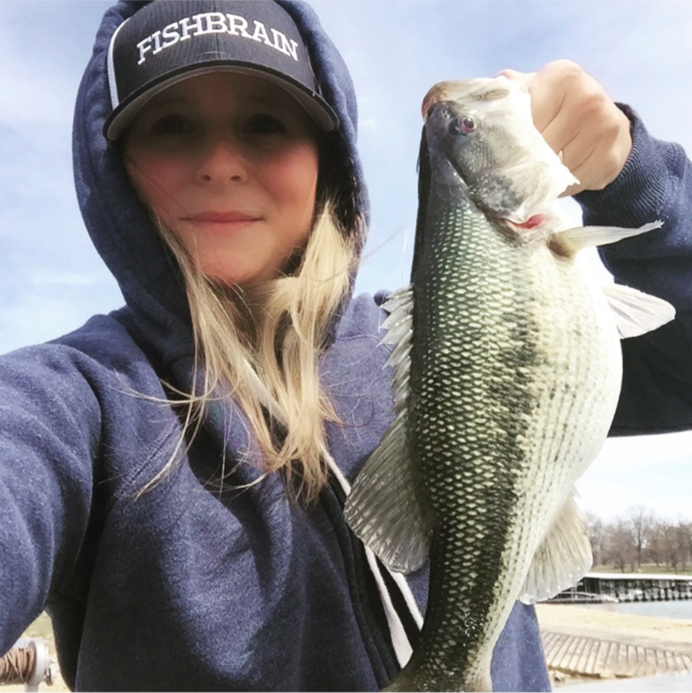 Nichole Delio holding her first-ever spotted bass...