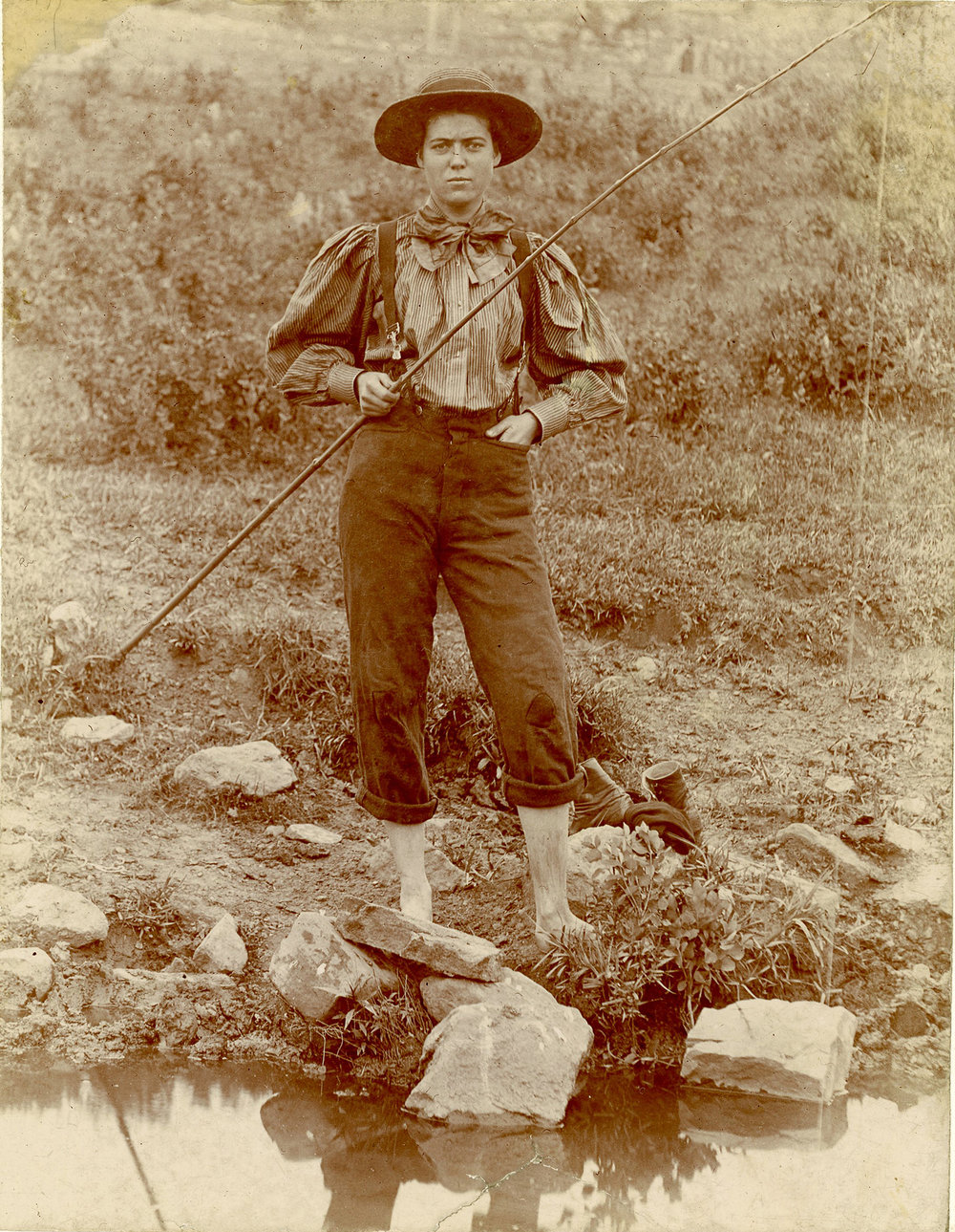 Albumen print of young woman fishing at Yellowstone Park, ca. 1895