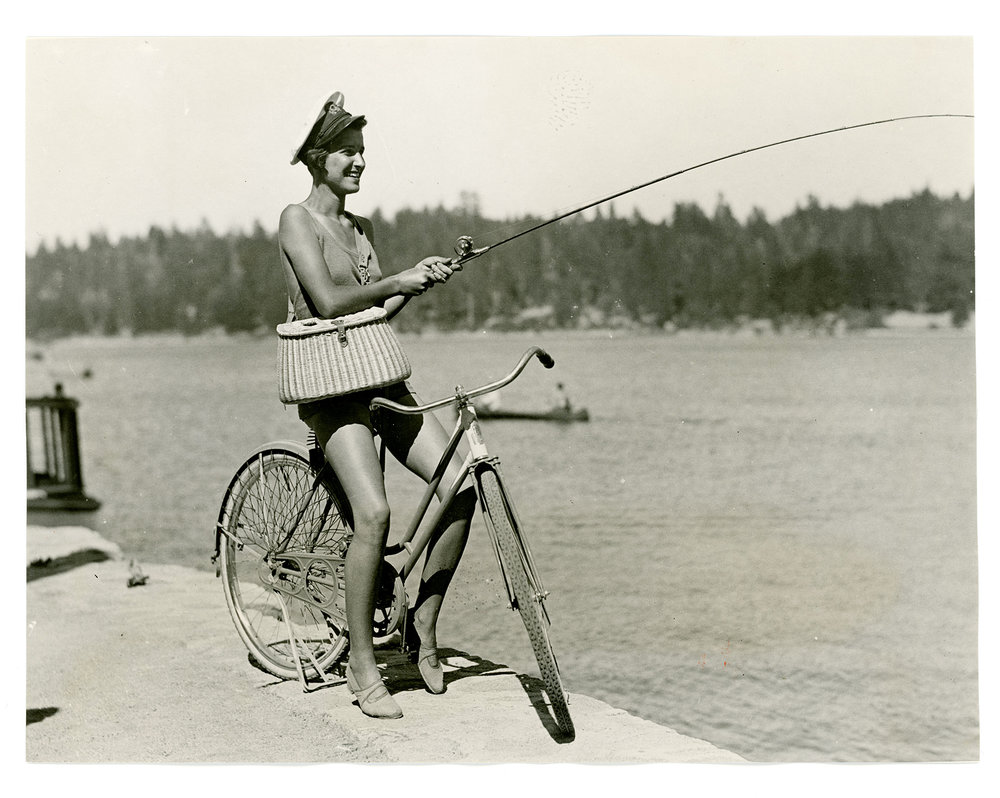 Fishing on a bicycle, Lake Arrowhead, California, 1933