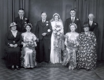 FRANK BARNES AND VIOLET (NEL) GREGORY WEDDING at St Peters Church Spring Hill June 5th 1937 Back row LtoR; Arthur Barnes, Harry Gregory junior, Harry Gregory with his wife Louisa seated in front, both were killed in Roseberry Street by enemy action on the 28/7/1942. Seated LtoR; Mrs Barnes, Kathleen Barnes, Katy Malpas