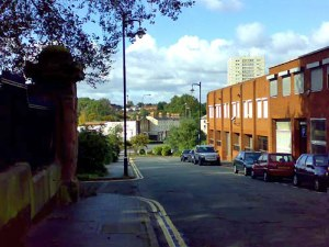 The  Flat from KEY HILL: A distant view of the Flat from Key Hill with the cemetery railings on the left and Icknield Street going across left to right.