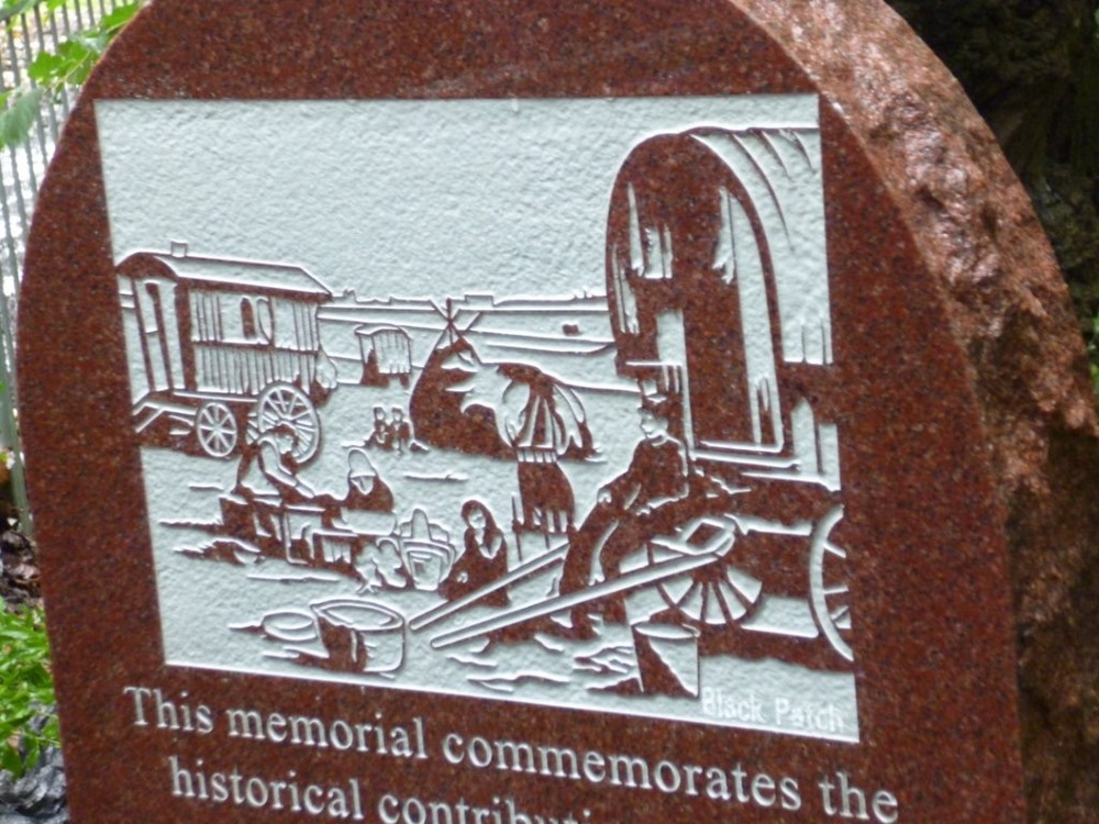 ETCHED ON THE NEW MEMORIAL IS A SCENE OF THE BLACK PATCH ROMANY GYPSY CAMP