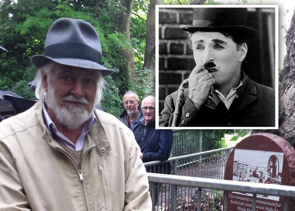 MICHAEL CHAPLIN 26/07/15 WITH A PHOTO OF HIS DAD CHARLIE INSERTED