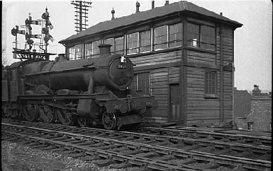 "Ex GWR 4-6-0 No 7900 ""St Peters Hall"" passing Soho and Winson Green signal box in 1956                                   Photo Copyright ""D K.JONES collection"" with thanks."