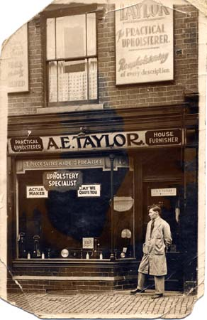 ALBERT TAYLOR OUTSIDE HIS SHOP IN HINGESTON STREET .