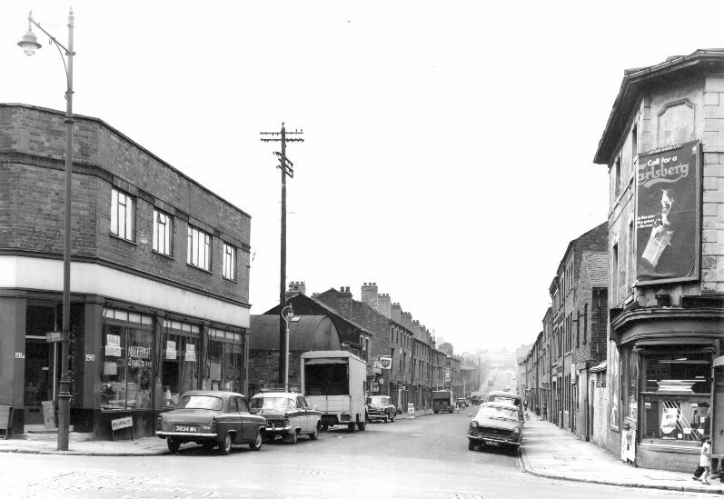 NEW SPRING STREET VIEWED FROM ICKNIELD STREET. Andrews mother Ethel Cooper lived at number 5 back of number 15 New Spring Street (5/15). Located on the left of the photograph just past the BP sign.                                           Read more in the entry below from Ethel's son Andrew.