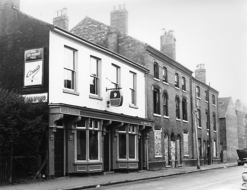 """SIR ROBERT PEEL"" PUBLIC HOUSE---PEEL STREET----1972 just before the old houses were demolished."
