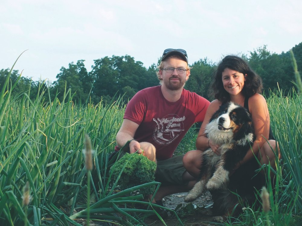Farmers Kara Cusolito and Aaron Munzer pose with their dog, Lena, on Plowbreak Farm.  Photo Courtesy of Kara Cusolito.