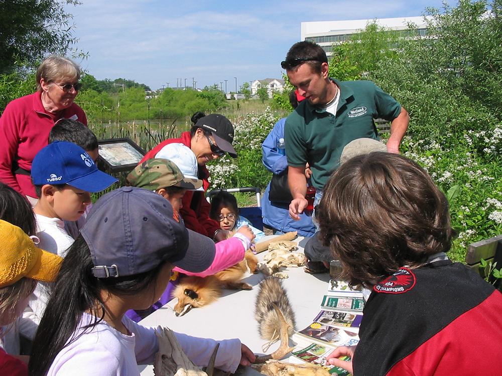 WSSI biologist at an educational event at Sunrise Valley Nature Park