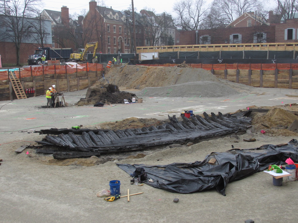 Just beyond the recovered 18th-century ship's hull, WSSI archeologists excavate an 18th-century privy.