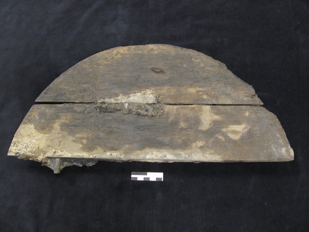Wooden barrel head fragment recovered from the Carlyle warehouse.