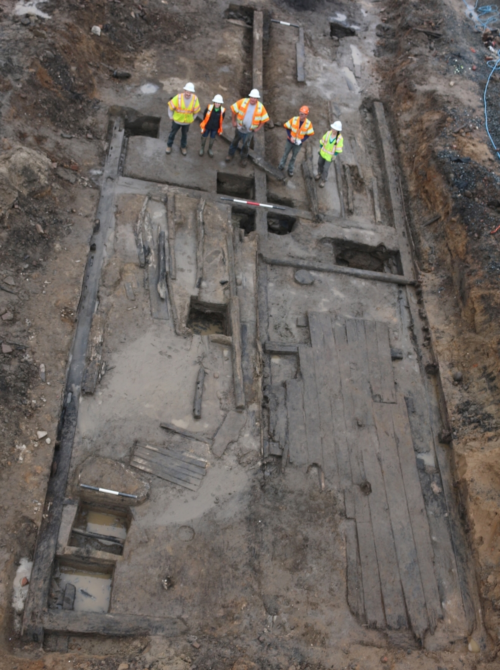 Aerial view of WSSI staff standing on the remnants of the Carlyle warehouse, Alexandria's first public warehouse.