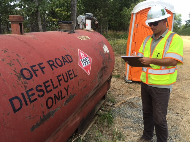 WSSI compliance staff performing a VSMP site inspection, documenting concerns with Pollution Prevention practices at a local site