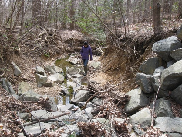 Old riprap stabilization at an exposed sanitary sewer