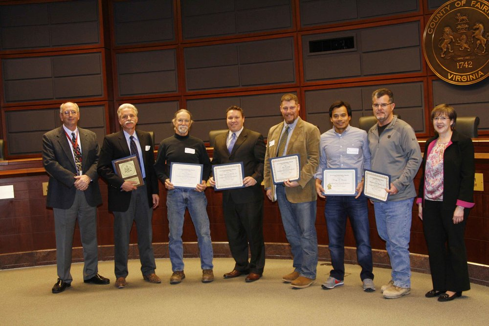 J.T. Kelley and Jason Beeler (center) accepted the award from Fairfax County on behalf of WSSI.